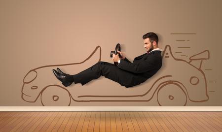 Photo pour Happy man driving an hand drawn car on the wall concept - image libre de droit