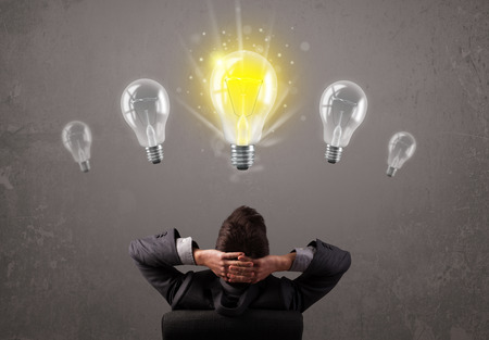 Photo for Business person having an bright idea light bulb concept - Royalty Free Image