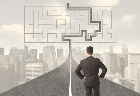 Photo pour Businessman looking at road with maze and solution concept - image libre de droit