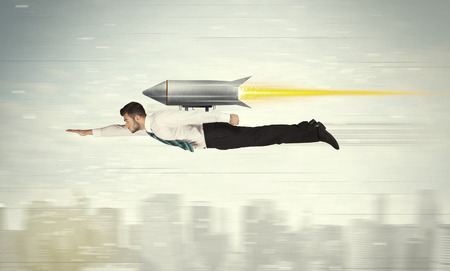 Photo for Superhero business man flying with jet pack rocket above the city concept - Royalty Free Image