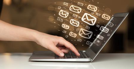 Photo pour Concept of sending e-mails from your computer - image libre de droit