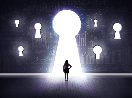 Photo for Successful businessman looking through keyhole - Royalty Free Image
