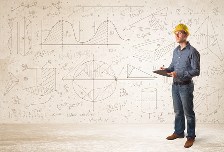 Photo pour Handsome engineer calculating with hand drawn background concept - image libre de droit