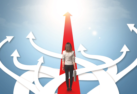 Photo for Concept of confused businesswoman with different direction arrows - Royalty Free Image