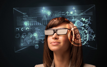 Foto de Young woman looking with futuristic smart high tech glasses concept - Imagen libre de derechos