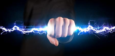 Foto de Business man holding electricity light bolt in his hands concept - Imagen libre de derechos