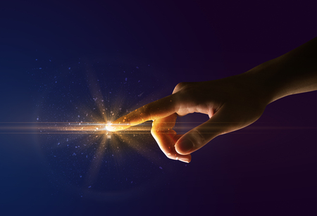 Photo pour Female finger touching a beam of light - image libre de droit