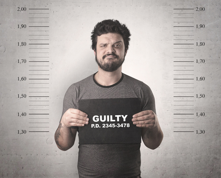 Photo for Caught guilty man with ID signs on his hand. - Royalty Free Image