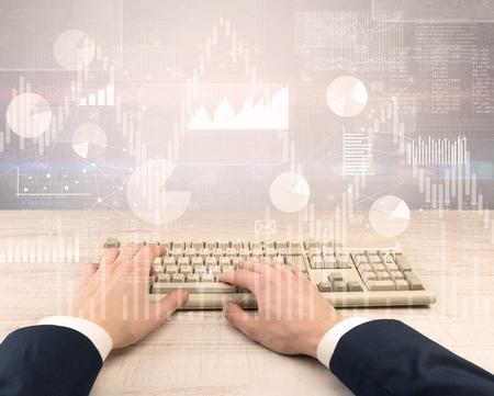 Foto de Male hand in a business suit typing financials concept - Imagen libre de derechos