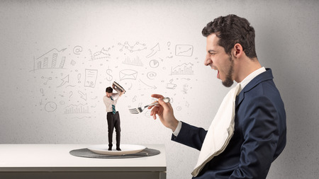 Photo pour Big businessman eating small employee with doodled charts concept - image libre de droit