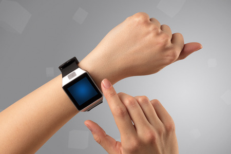 Foto per Female hand wearing smartwatch - Immagine Royalty Free