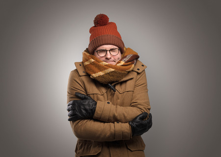 Photo for Handsome boy freezing in warm clothing - Royalty Free Image