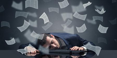 Foto de Businessman fell asleep at the office with paperwork concept - Imagen libre de derechos
