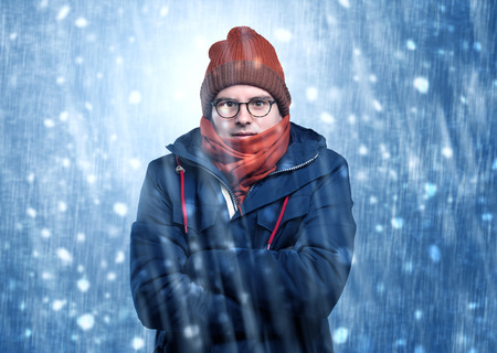 Photo for Handsome boy shivering at snowstorm concept - Royalty Free Image
