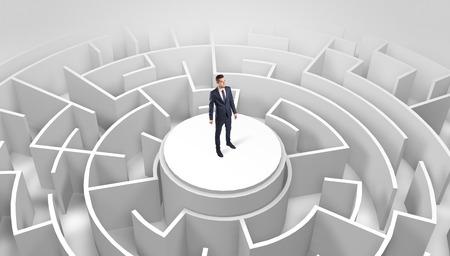 Photo pour Businessman standing on the top of a maze - image libre de droit
