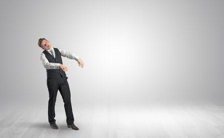 Foto de Zombi, sleepy maniac businessman walking in a copy space - Imagen libre de derechos