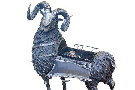 Foto de Metal roaster in the shape of a ram, isolated on a white background - Imagen libre de derechos