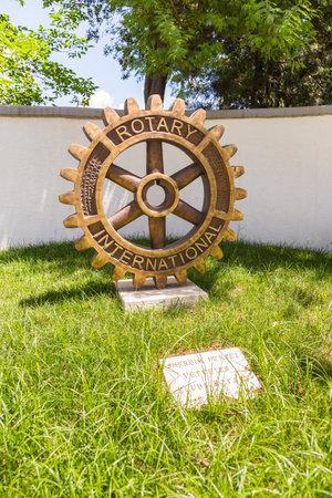 Photo for Tirana, Albania-01 July 2014: Rotary Club Monument in the center Tirana. International service organization. - Royalty Free Image
