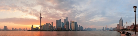 Photo for Shanghai morning city skyline silhouette over river - Royalty Free Image