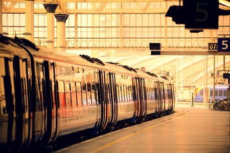 Photo pour Train on platform in station in London - image libre de droit