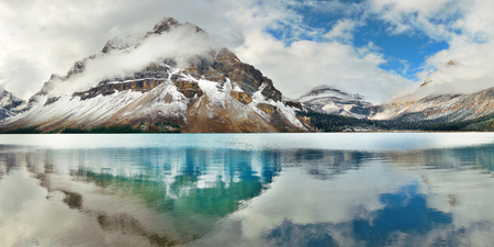 Photo for Bow Lake panorama reflection with snow capped mountain and forest in Banff National Park - Royalty Free Image