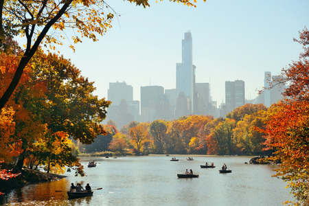 Photo for People boating in lake in Central Park in Autumn New York City - Royalty Free Image