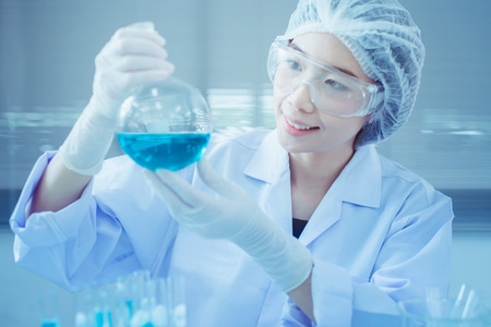 Foto de Laboratory scientist working at lab with test tubes - Imagen libre de derechos