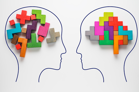 Foto de The concept of rational and irrational thinking of two people. Heads of two people with colourful shapes of abstract brain for concept of idea and teamwork. Two people with different thinking.  - Imagen libre de derechos