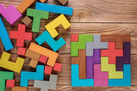 Foto de Logical tasks composed of colorful wooden shapes. Visual conundrum. Concept of creative, logical thinking or problem solving. Business concept, rational solution. - Imagen libre de derechos