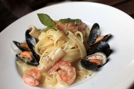 Pasta with seafood on a plate in an italian restaurant