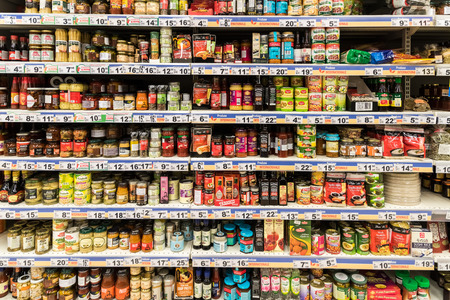 Photo pour BUCHAREST, ROMANIA - DECEMBER 06, 2014: Canned Food And Special Sauces On Supermarket Stand. - image libre de droit