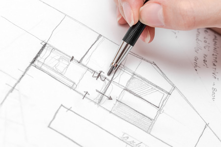 Foto de Architect Hand Drawing House Plan Sketch With Pencil - Imagen libre de derechos