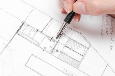 Photo pour Architect Hand Drawing House Plan Sketch With Pencil - image libre de droit