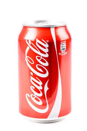 Foto de BUCHAREST, ROMANIA - JANUARY 16, 2016: Coca-Cola is a famous carbonated soft drink sold in stores, restaurants, and vending machines around the world. - Imagen libre de derechos
