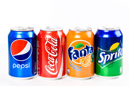 Foto de BUCHAREST, ROMANIA - JANUARY 16, 2016: Pepsi, Coca Cola, Sprite And Fanta are the most famous carbonated soft drinks sold in stores, restaurants, and vending machines all around the world. - Imagen libre de derechos