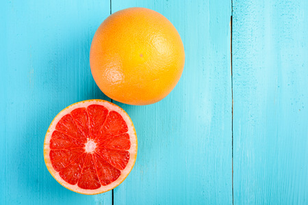 Photo for Fresh Red Grapefruit Slice On Wood Table - Royalty Free Image