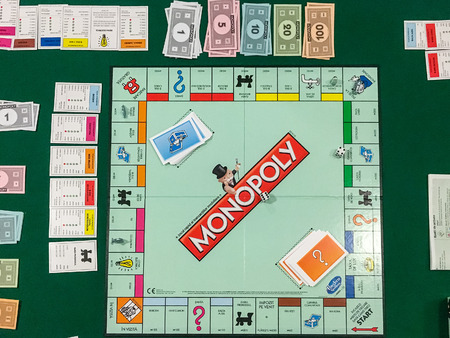 Foto de BUCHAREST, ROMANIA - JANUARY 01, 2016: Monopoly is a board game that originated in the United States in 1903 and the current version was first published by Parker Brothers in 1935. - Imagen libre de derechos