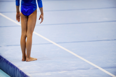 Photo pour Feet of gymnast are seen on the floor exercise before gymnastics competition - image libre de droit