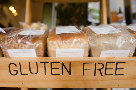 Foto de Gluten Free loaf of breads on display in a health food shop. - Imagen libre de derechos