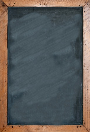 Foto de Blank chalkboard with brown wooben frame. Empty space for insertion and to add text. - Imagen libre de derechos