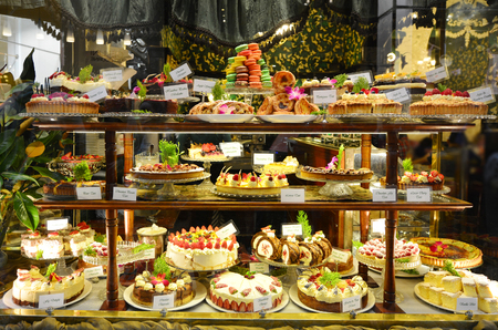 Photo for Pastry shop display window with variety of cakes. - Royalty Free Image