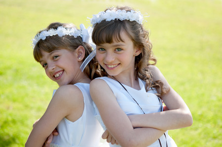 Photo for Young girls doing her catholic first holy communion - Royalty Free Image