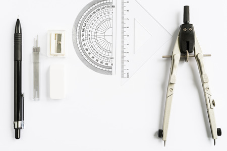 Photo pour Set of measuring tools with compass, pencil and rulers on white background from above - image libre de droit