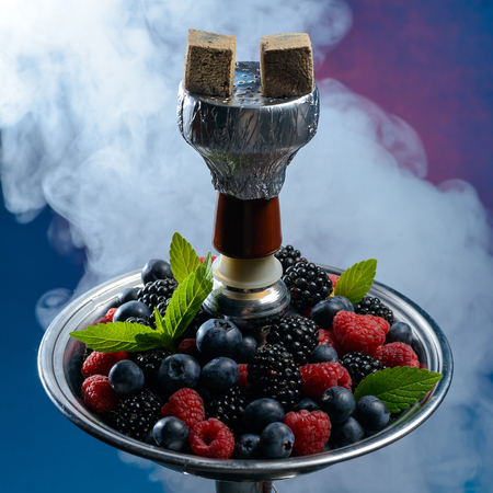 Photo for Closeup of hookah with tray full of berries - Royalty Free Image
