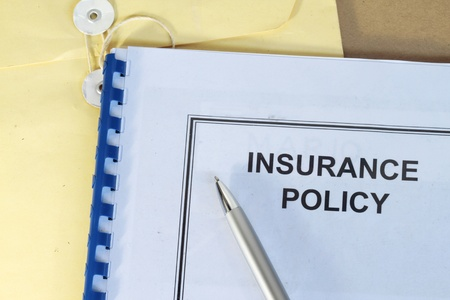 Photo pour insurance policy folder on desk in office with pen and manila envelop - image libre de droit