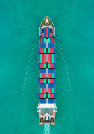 Foto de Aerial view container ship driving on the sea for delivery containers shipment. Suitable use for transport or import export to global logistics concept. - Imagen libre de derechos