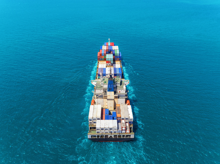 Foto de Aerial view container ship at sea full load container for logistics import  export or transportation concept background. - Imagen libre de derechos