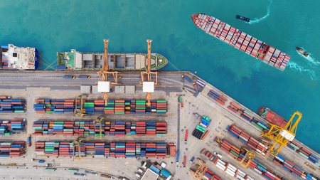 Photo pour Aerial top view container ship at sea port and working crane bridge loading container for import export, shipping or transportation concept background. - image libre de droit