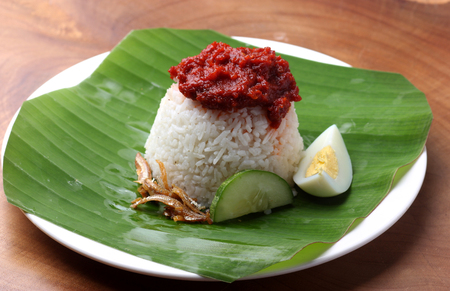 Photo for Nasi Lemak, a famous Malaysian food served on banana leaf - Royalty Free Image