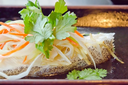 close up steamed white fish fillet with  vegetable